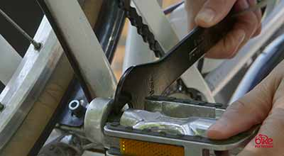 Using a pedal wrench on a bike