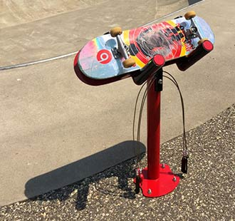 Skateboard repair stand in use
