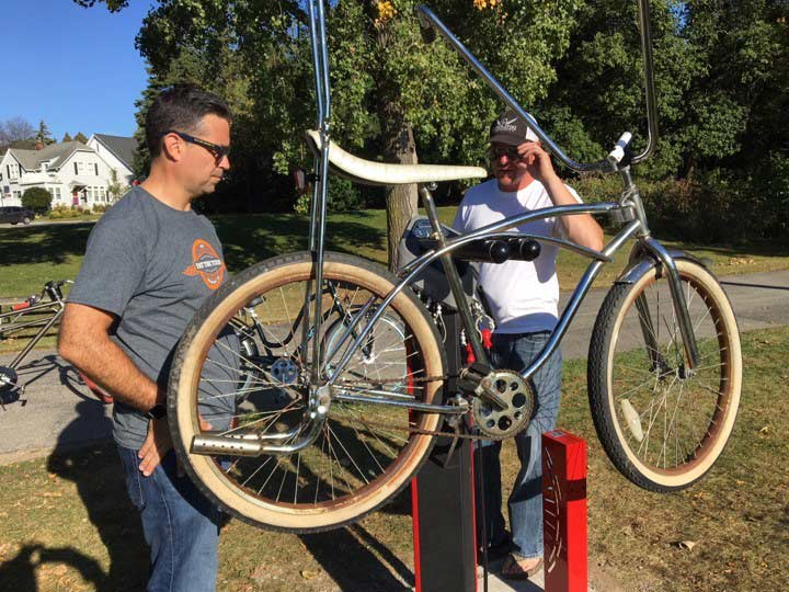 A Green Bay local mounts up his chopper bike to try out the newly installed repair stand.