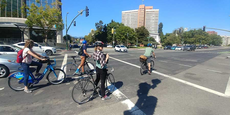 Cyclists in downtown Oakland utilize both personal and shared bikes