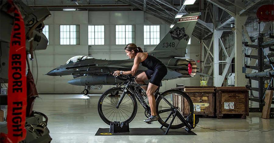 Cyclist on an indoor bike trainer at Truax Airfield in Madison, WI