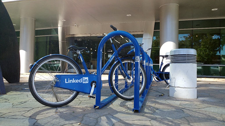 LinkedIn's campus bikes docked onto a Saris stadium bike rack outside their offices in Sunnyvale