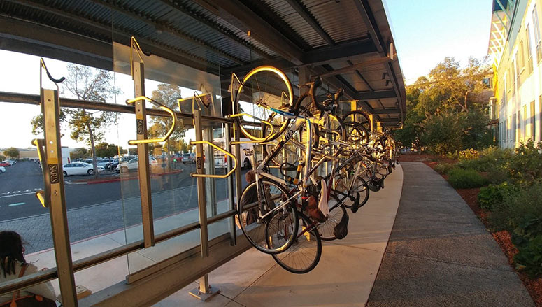 An array of Saris Bike Tracs mounted at the bus commuter pick up at Facebook's Menlo Park headquarters.