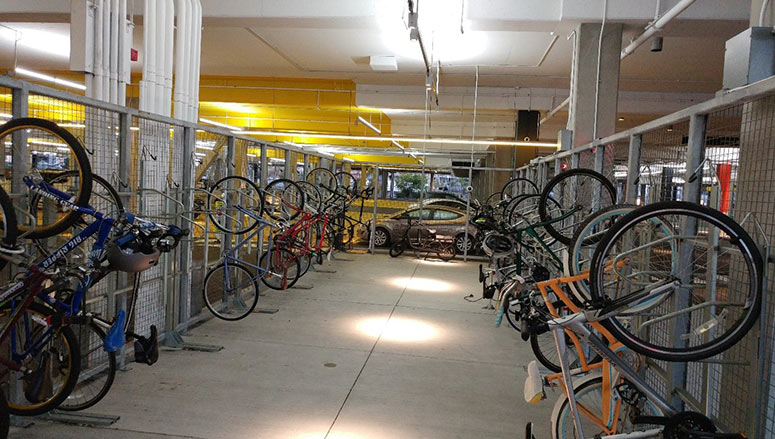 A secured and video monitored bike parking and storage area at Facebook's new campus allows employees peace of mind while storing their bicycles during the workday