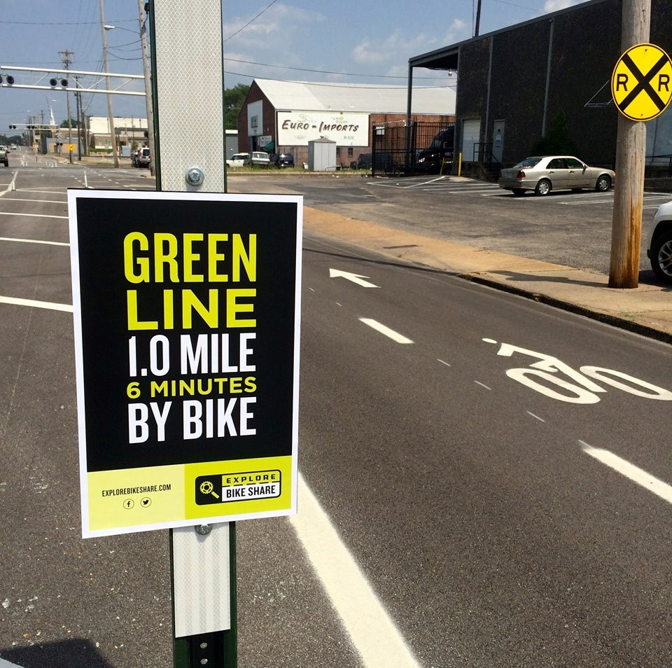 Cycling sign: Green line 6 minutes by bike