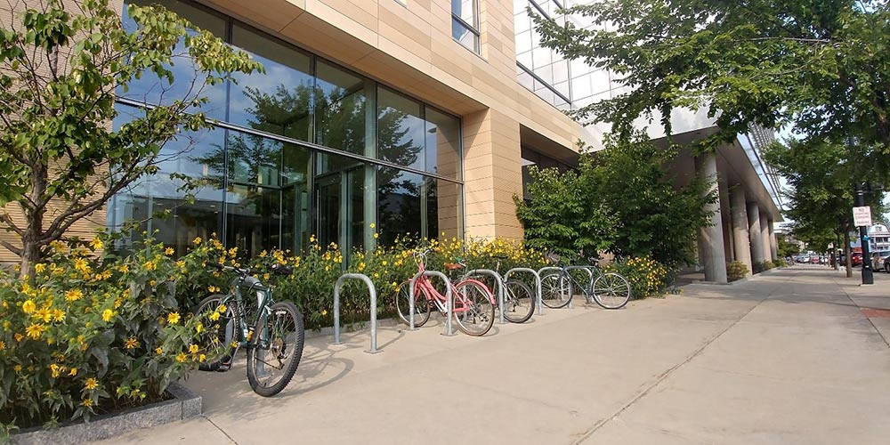 Bicycle racks and protected bicycle lanes shown outside The Wisconsin Institute for Discovery