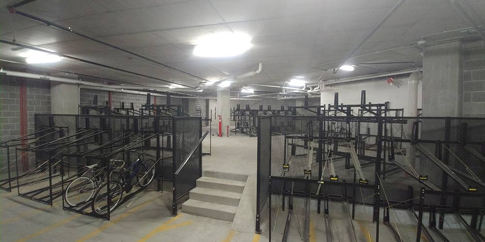 A large bicycle storage area complete with repair stand and pump